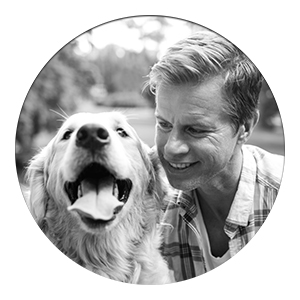 black and white photo of man and his dog